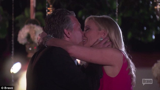 Pucker up: They share a sweet kiss after he appears to surprise her with a romantic evening