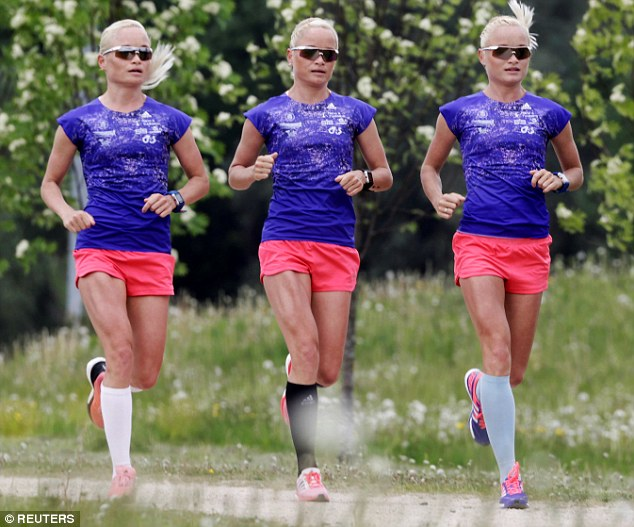 Record setters: (l-r) Lily, Liina and Leila Luik are believed to be the first identical triplets to compete against each other in the games' 120-year history