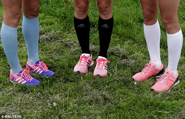 Patriotic: (L-R) Leila, Liina and Lily Luik wear socks in Estonia's national colours