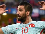 epa05382366 Arda Turan of Turkey reacts during the UEFA EURO 2016 group D preliminary round match between Czech Republic and Turkey at Stade Bollaert-Delelis in Lens Agglomeration, France, 21 June 2016. (RESTRICTIONS APPLY: For editorial news reporting purposes only. Not used for commercial or marketing purposes without prior written approval of UEFA. Images must appear as still images and must not emulate match action video footage. Photographs published in online publications (whether via the Internet or otherwise) shall have an interval of at least 20 seconds between the posting.)  EPA/ANDY RAIN   EDITORIAL USE ONLY