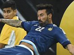 Argentina's Ezequiel Lavezzi falls behind a billboard during the Copa America Centenario semifinal football match against USA in Houston, Texas, United States, on June 21, 2016.  / AFP PHOTO / Mark RALSTONMARK RALSTON/AFP/Getty Images