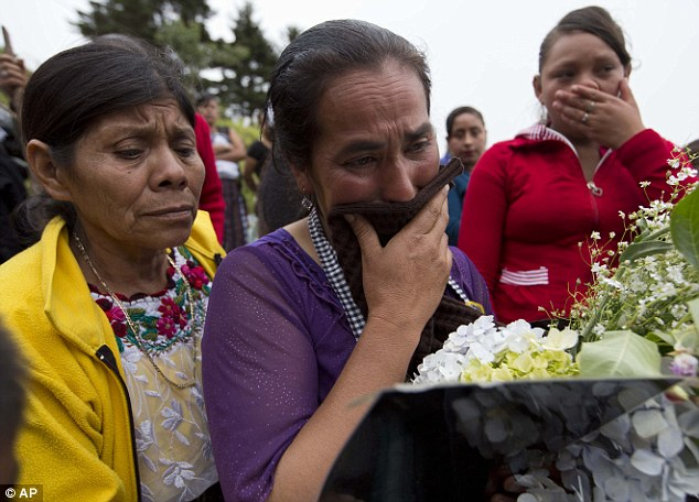 Heartbroken: Cipriana Juarez Diaz weeps for her son at the teen's funeral