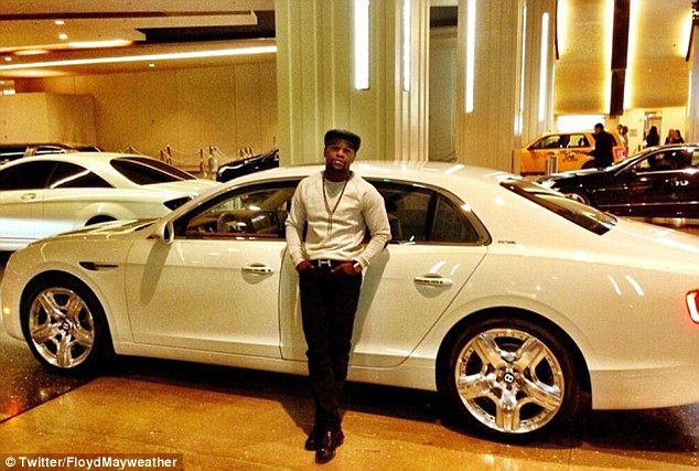 Mayweather posted a picture of himself with a Bentley Flying Spur back in 2013 on Twitter, alongside the message: 'Enjoying my night'