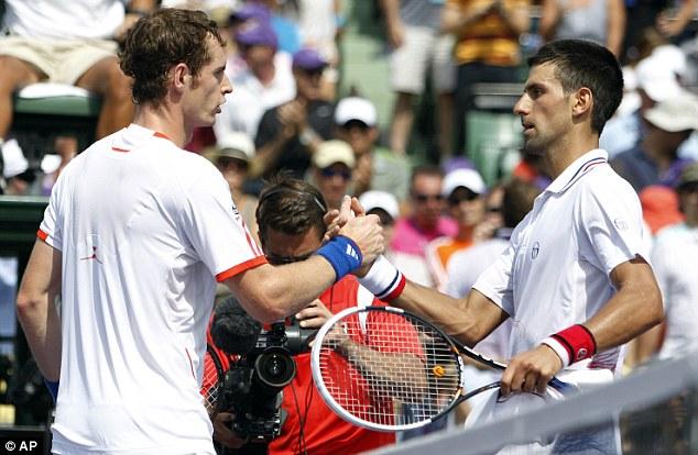 Well played: Murray (left) congratulates Djokovic
