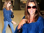 EXCLUSIVE TO INF.\nJune 21, 2016: American supermodel Cindy Crawford arrives at Washington Dulles International Airport in Washington D.C., Virginia.\nMandatory Credit: INFphoto.com Ref: infusdc-08