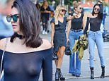June 21, 2016: IT girls Hailey Baldwin, Kendall Jenner, Gigi Hadid seen out together after having dinner at The Smile in Soho, New York City.  Kendall wore a sheer top that showed off her nipple piercing, while Baldwin and Hadid went for a more subtle look.\nMandatory Credit: INFphoto.com Ref.: inf-00