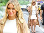 Hilary Duff is all smiling while out and about in Midtown, New York City, the actress wore a mini white dress under a  caramel striped  coat, she was heading into a meetings after her appearance at the Access Hollywood Live\n\nPictured: Hilary Duff\nRef: SPL1307402  230616  \nPicture by: Felipe Ramales / Splash News\n\nSplash News and Pictures\nLos Angeles: 310-821-2666\nNew York: 212-619-2666\nLondon: 870-934-2666\nphotodesk@splashnews.com\n