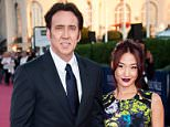 DEAUVILLE, FRANCE - SEPTEMBER 02:  Nicolas Cage and his wife Alice Kim arrive at the premiere of the movie 'Joe' during the 39th Deauville American film festival on September 2, 2013 in Deauville, France.  (Photo by Francois Durand/Getty Images)