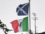 ABERDEEN, SCOTLAND - JUNE 25:  Properties bordering Trump International Golf Links fly the Mexican flag on June 25, 2016 in Aberdeen, Scotland. US presidential hopeful Donald Trump was in Scotland for the reopening of the refurbished Open venue golf resort Trump Turnberry which has undergone an eight month refurbishment as part of an investment thought to be worth in the region of two hundred million pounds.  (Photo by Jeff J Mitchell/Getty Images)
