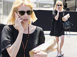 West Hollywood, CA - Emma Roberts wears a black dress and rosary beads as she stops by a liquor store on her way home along Sunset Blvd in West Hollywood.\n AKM-GSI June 24, 2016\n \n To License These Photos, Please Contact :\n \n Maria Buda\n (917) 242-1505\n mbuda@akmgsi.com\n sales@akmgsi.com\n \n or \n \n Mark Satter\n (317) 691-9592\n msatter@akmgsi.com\n sales@akmgsi.com\n www.akmgsi.com\n