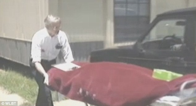 Murdered: The body of Tammy Ellis Gatlin is taken from her home after was shot by her estranged husband
