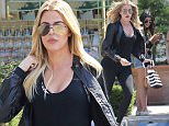 Khloe Kardashian was looking fit and trim in dark shades of work out gear.  The reality star was out and about in Calabasas, visiting Sephora at the Commons, on Saturday, June 25, 2015 X17online.com