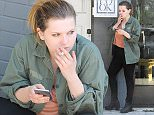 *EXCLUSIVE* West Hollywood, CA - 20-year-old actress Abigail Breslin enjoys a cigarette while checking her cell phone after grabbing a bite with a few friends. She kept it simple with an army green jacket over her blouse, black  jeans and black leather boots.\nAKM-GSI     June 25, 2016\nTo License These Photos, Please Contact :\nMaria Buda\n(917) 242-1505\nmbuda@akmgsi.com\nsales@akmgsi.com\nor \nMark Satter\n (317) 691-9592\n msatter@akmgsi.com\n sales@akmgsi.com\n www.akmgsi.com