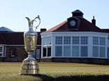The Claret Jug trophy beside the 18th green in front of the clubhouse during The Open Championship media day at Muirfield on April 29, 2013 in Gullane, Scotland.    GULLANE, SCOTLAND - APRIL 29:   (Photo by Ross Kinnaird/Getty Images)