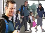 EXCLUSIVE FAO DAILY MAIL ONLINE - FEE AGREED Mandatory Credit: Photo by Tania Coetzee/REX/Shutterstock (5737119o) Matthew Mc Conaughey with his wife Camila Alves and children Matthew McConaughey at Cape Town Airport, South Africa - 26 Jun 2016 Matthew McConaughey and his wife Camila Alves flew out of Cape Town on Sunday with their 3 children, Levi, Livingstone and Vida. The family have been in South Africa for several weeks while Matthew filmed his latest movie, Stephen King's 'The Dark Tower', alongside Idris Elba. McConaughey refused to comment on his role and looked tense when he arrived clutching 4 take away fruit smoothies. Camila and daughter Vida had opted for new hair styles with matching braids and posted a pic on Instagram