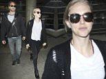 Amanda Seyfried and Thomas Sadoski seen at LAX Airport in Los Angeles, California.\n26 June 2016.\nPlease byline: Vantagenews.com