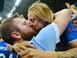 NICE, FRANCE - JUNE 27:  Aron Gunnarsson (L) of Iceland kisses his girlfirend Kris Jonasdottir (R) to celebrate the win after the UEFA EURO 2016 round of 16 match between England and Iceland at Allianz Riviera Stadium on June 27, 2016 in Nice, France.  (Photo by Dan Mullan/Getty Images)
