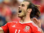 Editorial use only. No merchandising. For Football images FA and Premier League restrictions apply inc. no internet/mobile usage without FAPL license - for details contact Football Dataco Mandatory Credit: Photo by Joe Meredith/JMP/REX/Shutterstock (5736884ar) Gareth Bale of Wales celebrates with Wales fans after the game Wales v Northern Ireland, France - 25 Jun 2016