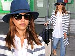 Actress, Jessica Alba wears a cool Grey and White Striped Jacket with a Blue Fedora Hat while arriving at Pearson International Airport in Toronto, Canada. Jessica Alba was seen wearing sheer white dress shirt underneath the striped jacket with sunglasses, blue jeans, tan dress shoes, while carrying a blue handbag and wheeling her luggage through the terminal. Jessica Alba is in Toronto to promote The Honest Company.\n\nPictured: Jessica Alba\nRef: SPL1305784  270616  \nPicture by: Splash News\n\nSplash News and Pictures\nLos Angeles: 310-821-2666\nNew York: 212-619-2666\nLondon: 870-934-2666\nphotodesk@splashnews.com\n
