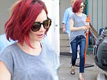 Beverly Hills, CA - Lily Collins keeps it casual while out in Beverly Hills. Lily wore a simple grey top, blue jeans with hem detail, and floral slides.\n  \nAKM-GSI       June 27, 2016\nTo License These Photos, Please Contact :\nMaria Buda\n(917) 242-1505\nmbuda@akmgsi.com\nsales@akmgsi.com\nMark Satter\n(317) 691-9592\nmsatter@akmgsi.com\nsales@akmgsi.com
