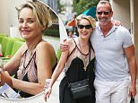 Beverly Hills, CA - Sharon Stone enjoys a pampering session at Beverly Hills Nail Design in Beverly Hills. Afterwards, Sharon shares a laugh with a unknown muscled male friend as they walk to the parking garage arm in arm with smiles ear to ear.\nAKM-GSI    June  28, 2016\nTo License These Photos, Please Contact :\nMaria Buda\n(917) 242-1505\nmbuda@akmgsi.com\nsales@akmgsi.com\nor \nMark Satter\n(317) 691-9592\nmsatter@akmgsi.com\nsales@akmgsi.com\nwww.akmgsi.com