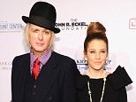 NEW YORK, NY - OCTOBER 15:  Michael Lockwood and Lisa Marie Presley attend the Elton John AIDS Foundation's 12th Annual An Enduring Vision Benefit at Cipriani Wall Street on October 15, 2013 in New York City.  (Photo by Dimitrios Kambouris/Getty Images)
