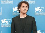 """Cast member Anton Yelchin poses during the photo call for the movie """"Cymbeline"""" at the 71st Venice Film Festival September 3, 2014. REUTERS/Tony Gentile/File Photo"""