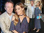Director Guy Ritchie and Jacqui Ainsley pose for photographers upon arrival at the Old Vic Summer Gala in London, Monday, June 27, 2016. (Photo by Joel Ryan/Invision/AP)
