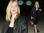 Elle Fanning wears all black with flower Gucci shoes and purse as she arrives at LAX airport in Los Angeles, CA\n\nPictured: Elle Fanning\nRef: SPL1307889  230616  \nPicture by: iPix211/London Ent/Splash News\n\nSplash News and Pictures\nLos Angeles: 310-821-2666\nNew York: 212-619-2666\nLondon: 870-934-2666\nphotodesk@splashnews.com\n