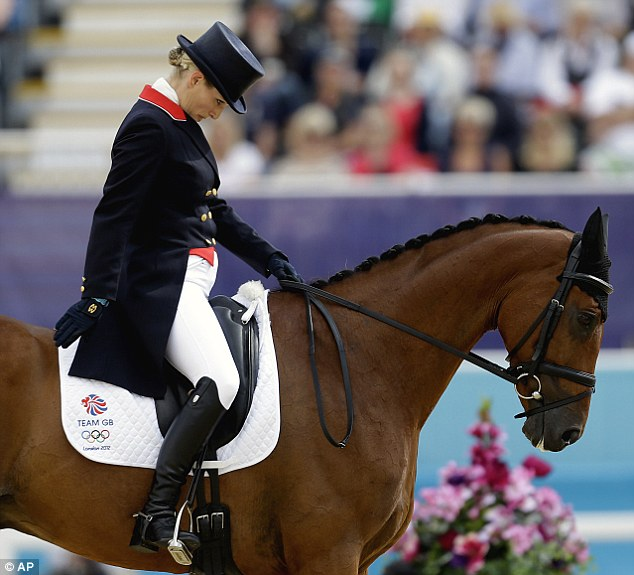 Take a bow: Zara Phillips, of Great Britain, competes with her horse High Kingdom, in the equestrian eventing dressage phase of the 2012 Olympics