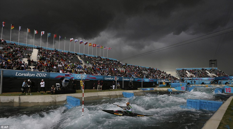 Dark skies overhead: These black clouds over the Lee Valley Whitewater Centre deposited a heavy rain shower on competitors in the in the heats of the K-1 men's canoe slalom