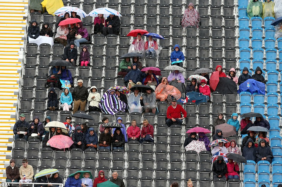 Keeping dry: The rain didn't dampen the spirits of spectators as they watched the Dressage stage of the Eventing at Greenwich Park