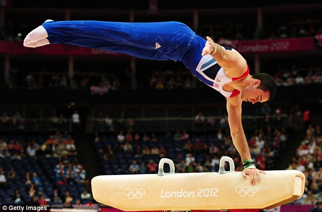 Star performer: Kristian Thomas of Great Britain competes in the gymnastics event. Viewers described the BBC's coverage of the competition as 'shocking'