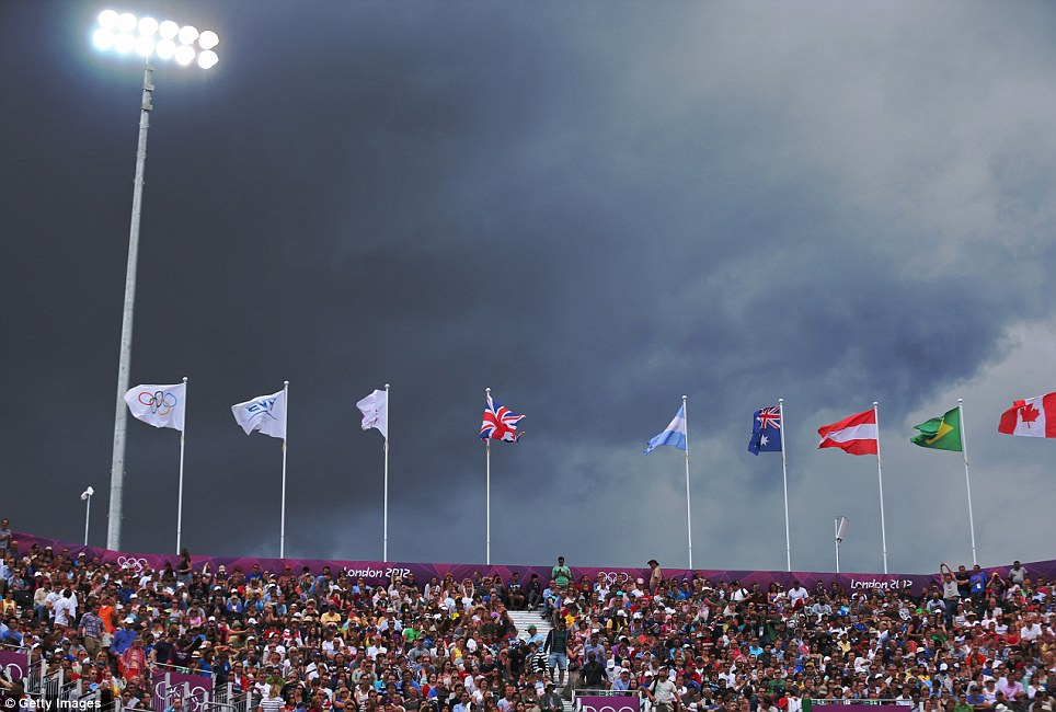 Dark skies over the men's beach volleyball match between Brazil and Austria on day two of the London 2012 Olympic Games