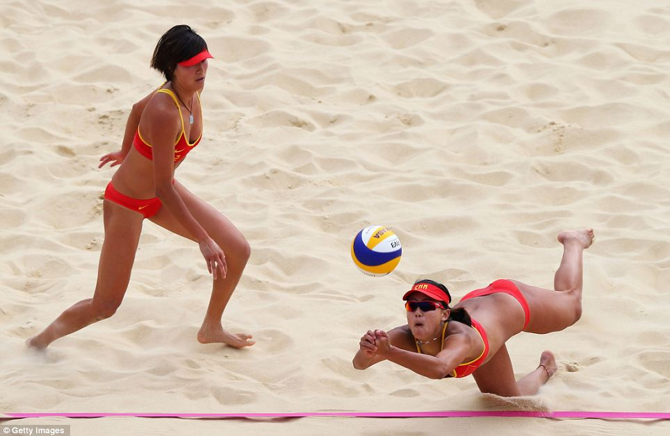 Good effort: Chen Xue of China dips to return the ball during the match, where they eventually went out to the Russian side