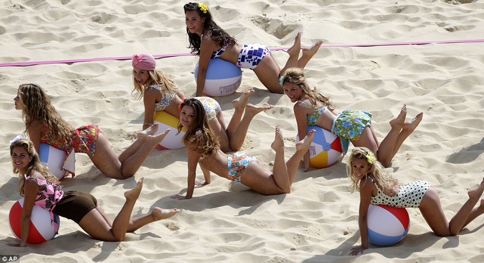 Bonkers: A group of dancers use beach balls during their routine to keep spectators entertained at the beach volleyball