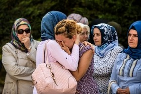 Relatives of a victim of the Ataturk airport attack mourn in Istanbul during his funeral. Ozan Kose / AFP