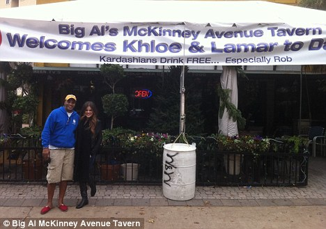 Warm welcome: Khloe Kardashian poses in front of a welcome banner for herself and Lamar in Dallas, Texas today