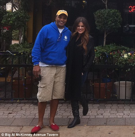 Happy: Khloe couldn't stop beaming as she cuddled up to Big Al