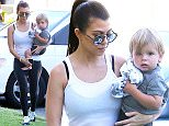 Kourtney Kardashian wears a sheer white tank, black sports bra, leggings and tennis shoes as she takes adorable son, Reign Disick to the doctor on a hot day in Calabasas\nJune 29 2016\nX17online.com\nOK FOR WEB SITE USAGE @ 20pp\nMagazine normal fees\nAny queries call X17 UK \nAlasdair 0121 250 4956 / 07922364885\nGary / Lynne 0034 966713949\nGary 0034 686421720\nLynne 0034 611100011