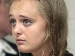 """FILE - In this Aug. 24, 2015, file photo, Michelle Carter listens to defense attorney Joseph P. Cataldo argue for an involuntary manslaughter charge against her to be dismissed at Juvenile Court in New Bedford, Mass. Carter, a teenager from Plainville, Mass., is charged with involuntary manslaughter in the 2014 death of Conrad Roy III. The Massachusetts Supreme Judicial Court ruled Friday, July 1, 2016, Carter must stand trial on a manslaughter charge for encouraging Roy to kill himself by sending him dozens of text messages and telling him to """"get back in"""" a truck filled with carbon monoxide fumes. (Peter Pereira/Standard Times via AP, Pool, File) MANDATORY CREDIT"""