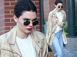 30.June.2016 - New York ñ USA\n*** STRICTLY AVAILABLE FOR UK AND GERMANY USE ONLY ***\nNew York, NY - Kendall Jenner seen in NYC wearing a helmet graphic print jacket, tan blouse, light jeans, furry handbag, and black boots.  She wore her hair slicked back, wore round sunglasses, and had ruby red lips.\nBYLINE MUST READ : AKM-GSI-XPOSURE\n***UK CLIENTS - PICTURES CONTAINING CHILDREN PLEASE PIXELATE FACE PRIOR TO PUBLICATION ***\n*UK CLIENTS MUST CALL PRIOR TO TV OR ONLINE USAGE PLEASE TELEPHONE 0208 344 2007*\n
