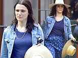 30 June 2016 - EXCLUSIVE.\nEXCLUSIVE: Rachel Weisz spotted out and about in Lower Manhattan today. The English film and theatre actress tucked into a local hat shop to change up her headgear on a hot day in the city. The former fashion model proved she can still cut a dash in long pattern blue skirt paired with a blue tee shirt and jean jacket. Finishing off her look with black ballet flats and a wide brim hat while carrying a spare unit in the event she is chooses to sport that double hat look. \nCredit: GoffPhotos/TheImageDirect   Ref: KGC-339/TIDNY-133\n**UK Sales Only - No Daily Mail Online, No Sun Online - Exclusive Papers Allrounder - Mags Double Space Rates - Web/Online Must Call Before Use**