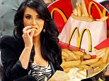 """Washington, UNITED STATES:  This photo illustration taken 21 February 2006 in Washington,DC shows McDonalds french fries. Fast-food giant McDonald's is being sued in the United States for failing to warn that its french fries contain gluten, a lawyer for a plaintiff in the case said 20 February 2006. """"McDonald's, through their websites, tell their managers to tell people that there are certain meal items that are gluten free,"""" including french fries, said Chicago attorney Thomas Pakenas, who represents plaintiff Debra Moffat. However, in response to new federal regulations, the burger chain recently said on its website that gluten and milk are used in manufacturing french fries, the lawyer added. Moffat, a mother of four in her mid-forties, is gluten intolerant, a condition called celiac disease that affects one out of every 133 Americans and a similar proportion of the population in northern Europe. AFP PHOTO/KAREN BLEIER   (Photo credit should read KAREN BLEIER/AFP/Getty Images)"""