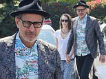 West Hollywood, CA - A dapper Jeff Goldblum ends a shopping trip to Fred Segal in West Hollywood with his wife Emilie Livingston. The pair smile for the camera's as they return to their car after a small shopping trip to the trendy LA store.\nAKM-GSI   July  5, 2016\nTo License These Photos, Please Contact :\nMaria Buda\n(917) 242-1505\nmbuda@akmgsi.com\nsales@akmgsi.com\nor \nMark Satter\n(317) 691-9592\nmsatter@akmgsi.com\nsales@akmgsi.com\nwww.akmgsi.com