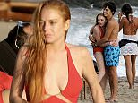 OIC - ENTSIMAGES.COM EXCLUSIVE -  Lindsay Lohan wearing a red bandage swimsuit, and fiance Egor Tarabasov continue her 30th birthday celebrations with family and friends at the beach in Mykonos, Greece. 4th July, 2016.Photo Mavrix photo Inc/OIC 0203 174 1069