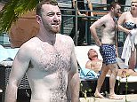 "4 July 2016 - PORTOFINO - ITALY *** EXCLUSIVE ALLROUND PICTURES NOT AVAILABLE FOR ITALY *** BRITISH GRAMMY AWARD WINNIG SINGER SAM SMITH PICTURED ENJOYING HIS VACATION AT RESORT ON THE LIGURIAN RIVIERA ""SESTRI LEVANTE"" WITH HIS FAMILY AND FRIENDS AS THEY ARE PICTURED SUNBATHING AND ENJOYING THE SWIMMING POOL OF THE HOTEL ""VIS A VIS"". BYLINE MUST READ : XPOSUREPHOTOS.COM ***UK CLIENTS - PICTURES CONTAINING CHILDREN PLEASE PIXELATE FACE PRIOR TO PUBLICATION *** **UK CLIENTS MUST CALL PRIOR TO TV OR ONLINE USAGE PLEASE TELEPHONE 44 208 370 0291**"