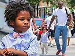Exclusive... 52114248 Actor Idris Elba and his son Winston are spotted out with a friend in New York City, New York on July 6, 2016. Winston got a little tired of walking so his daddy gave him a ride on his shoulders. FameFlynet, Inc - Beverly Hills, CA, USA - +1 (310) 505-9876