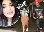 *EXCLUSIVE* Sherman Oaks, CA - Kylie Jenner and her on-again boyfriend, Tyga, leave a movie date night at Sherman Oaks ArcLight Cinema. The camera shy reality star wore a khaki bomber jacket over a knit midi dress and white Puma sneakers. Kylie covered her face with a Celine striped tote bag as she followed  Tyga to their ride.\n**SHOT ON 7/6/16**\nAKM-GSI      July 7, 2016\nTo License These Photos, Please Contact :\nMaria Buda\n(917) 242-1505\nmbuda@akmgsi.com\nsales@akmgsi.com\nor\nMark Satter\n(317) 691-9592\nmsatter@akmgsi.com\nsales@akmgsi.com\nwww.akmgsi.com