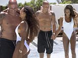 The mother of three took a romantic holiday with husband, Stephen Belafonte, at the Hard Rock Hotel Ibiza during the week of 4th of July.  Mel B celebrated her hiatus from America¿s Got Talent and The X-Factor and showed off her hot bikini body while on vacation in Ibiza.  The singer has recently loss nearly 30lbs and flaunted her rock hard abs at the Hard Rock Hotel Ibiza in a bright blue string bikini with a neon green ruffle trim and showed of her toned long legs in an ultra-sexy backless white one piece.  Even on holiday, Mel B kept up with her daily workout routine and hit the gym to run an hour on the treadmill ¿ and it showed!! \n\nThe couple enjoyed everything on the island from motorbike rides, paddle boarding, boating and relaxing in the sun at the pool and on the beautiful Mediterranean beaches at the Hard Rock Hotel Ibiza.  \n\n